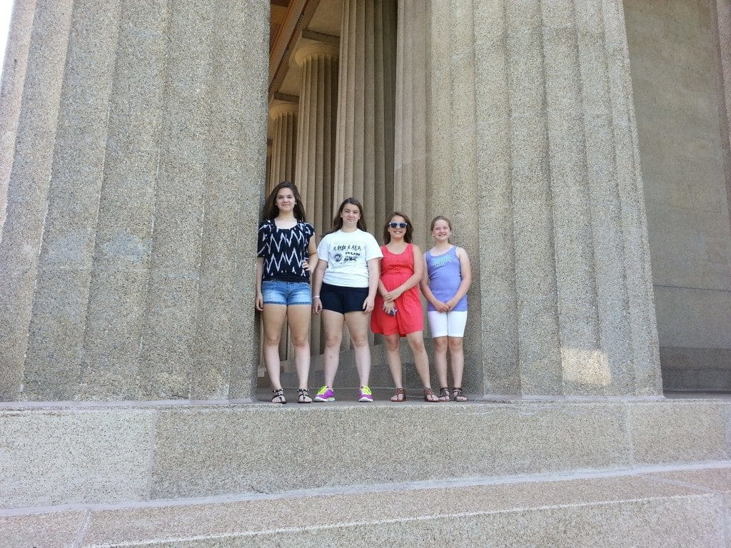 posing with The Parthenon columns
