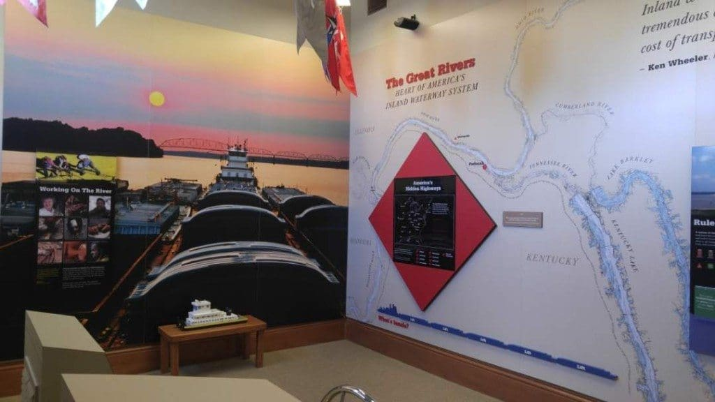 A map of the inland waterway system and a picture of a tug and barge on the walls of the River Discovery Center.