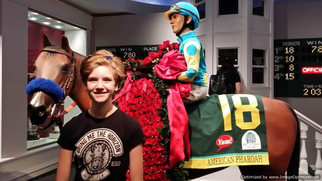 Churchill Downs & The Kentucky Derby posing with jockey on horse display