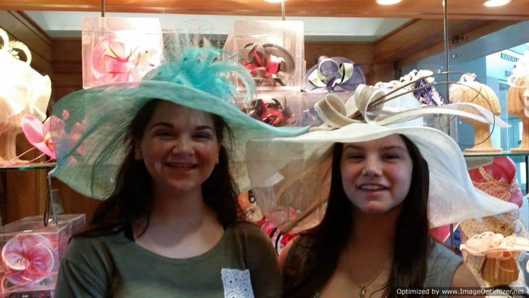 Churchill Downs & The Kentucky Derby trying on derby hats