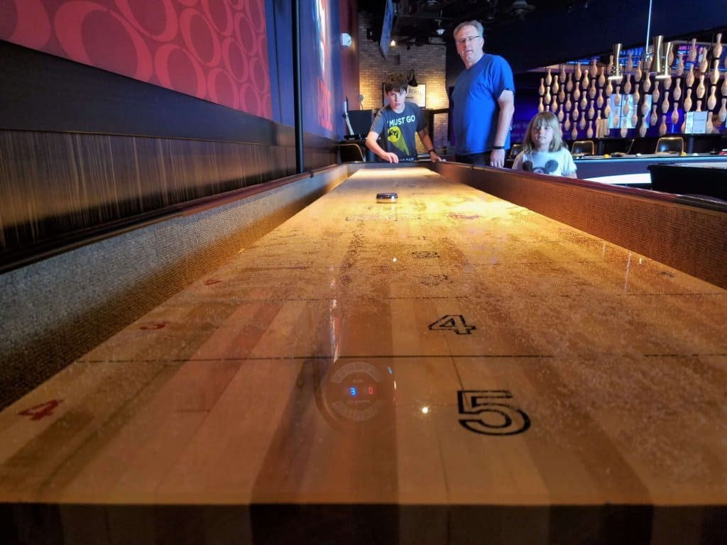 kings bowl shuffleboard from the end of the table