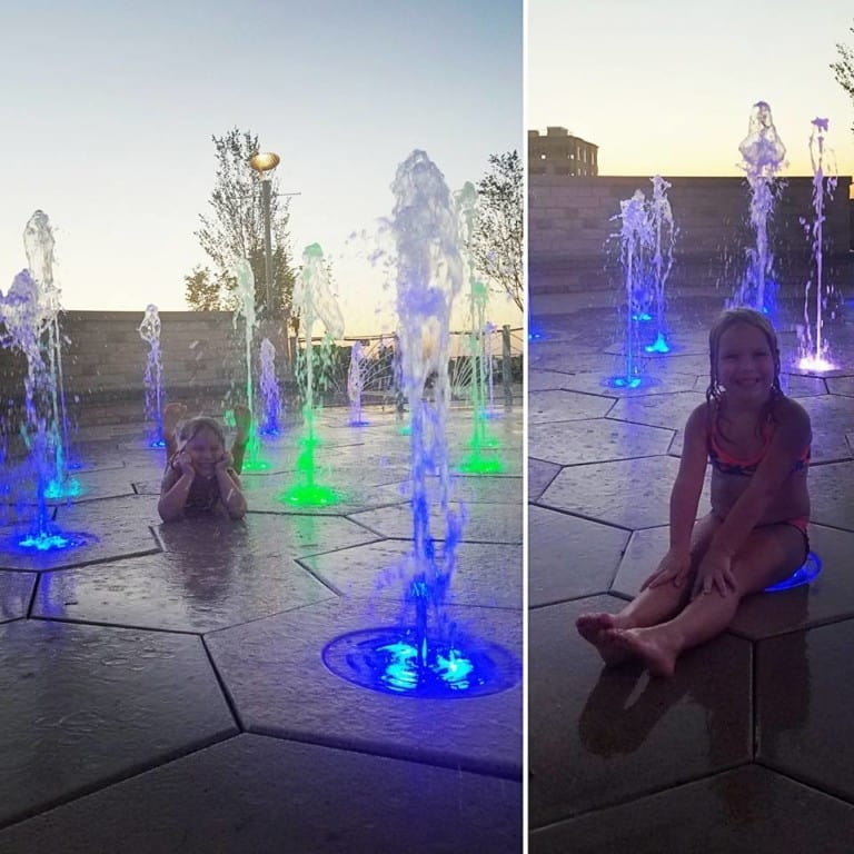 Fountains of Gateway Park - girl playing in the fountains at night
