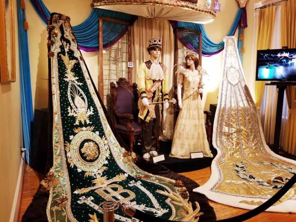 Mobile Carnival Museum Mardi King and Queen mannequin and Mardi Gras King train