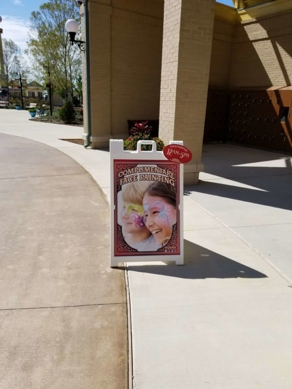 The Park at OWA face painting sign