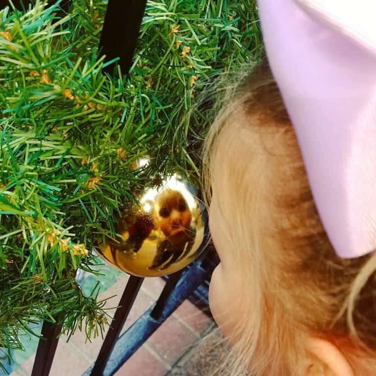 Gaylord Opryland's Build-a-bear workshop scavenger hunt - checking out a gold ornament