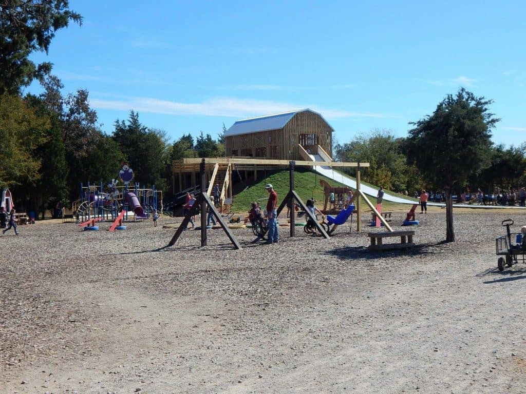Swings for big kids near the playground at Lucky Ladd Farms