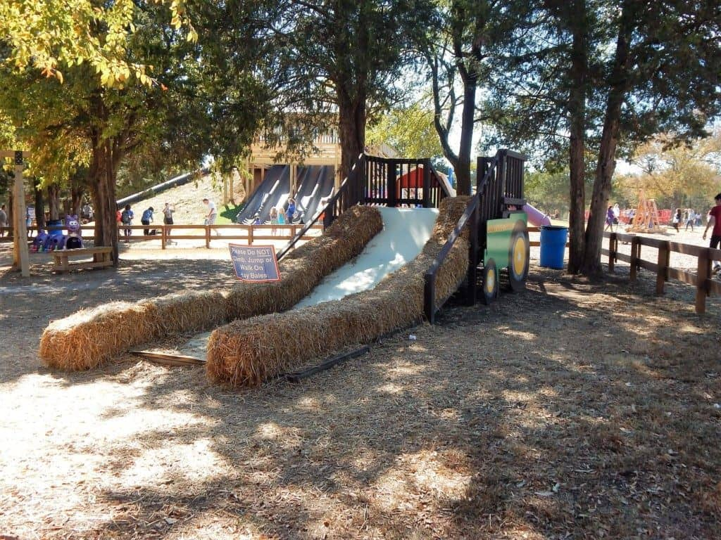 A long slide with hay bales as the sides at Lucky Ladd Farms