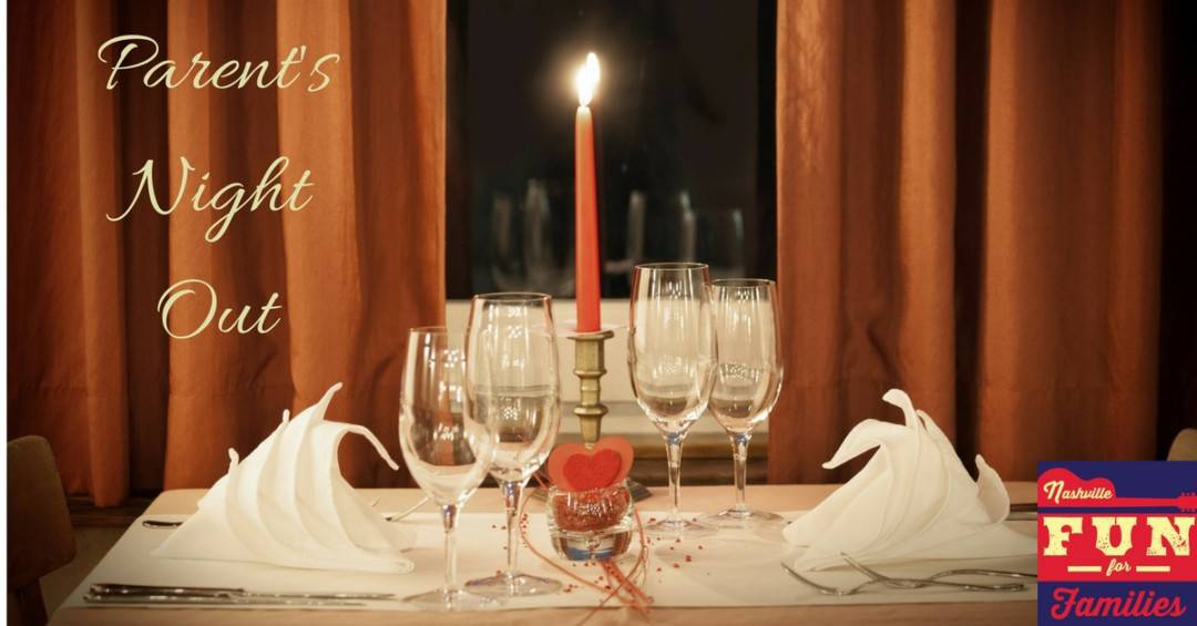 Parent's Night Out in Nashville - a table with a white table cloth, candlelight for a romantic setting