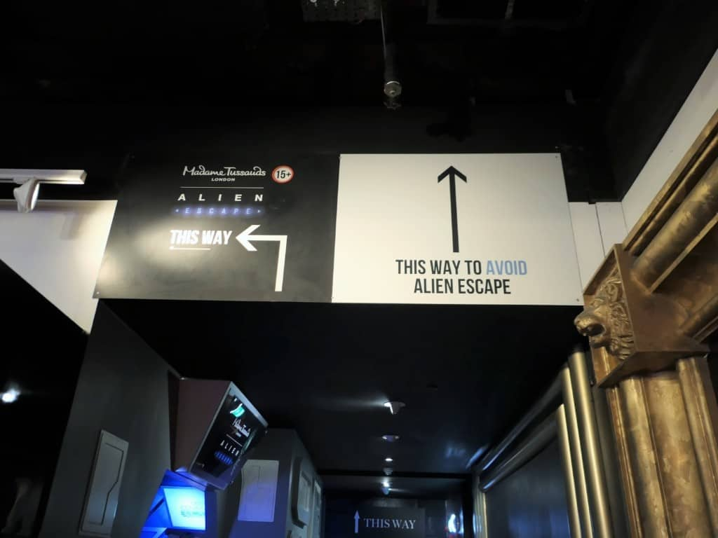 Signs to the Alien escape rooms in Madame Tussauds in London