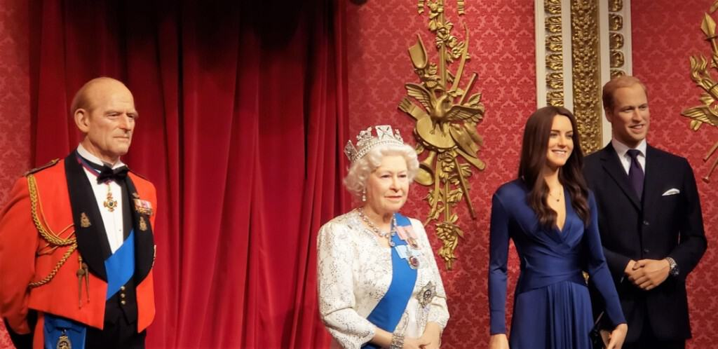 Queen Elizabeth, Prince Philip, and the Duke and Duchess of Cambridge in Madame Tussauds in London.