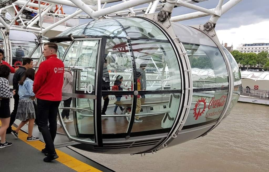 One of the pods on the London Eye open for boarding