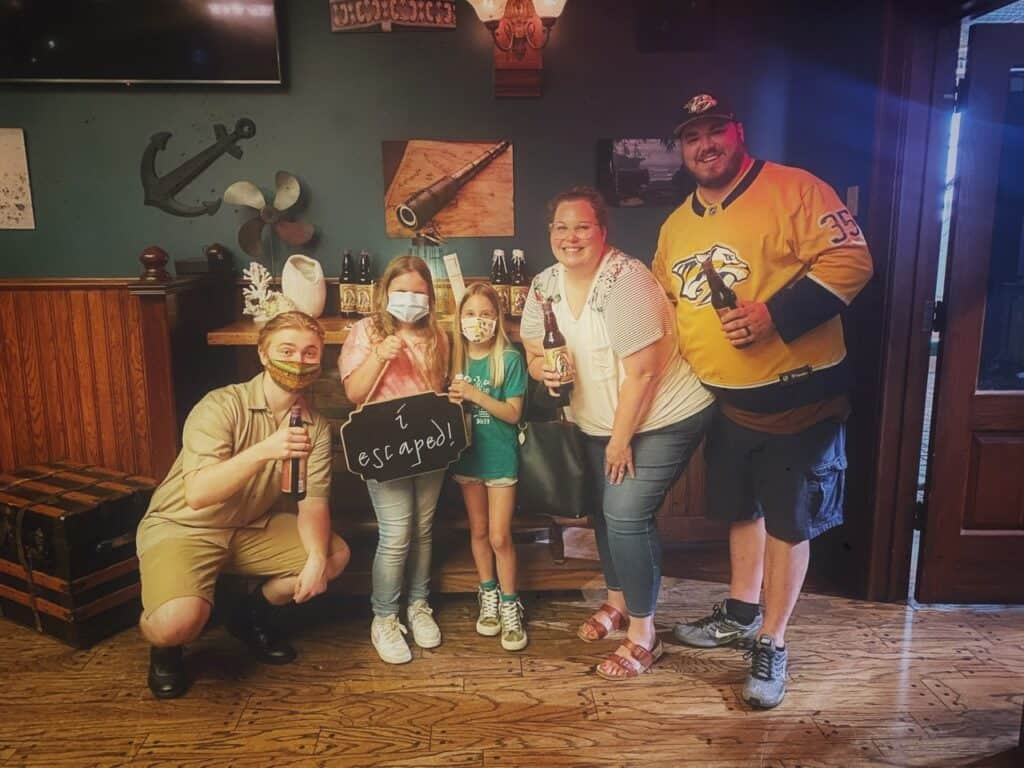 Family picture after escaping the escape room at the Summer of More at Gaylord Opryland